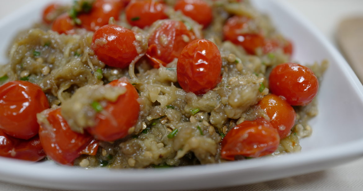 Eggplant Caviar (French) with Thyme-Roasted Tomatoes and Herbs (Paleo, Vegan, Keto, Plant-based) in a white dish on a beige tablecloth by Foodjoya.