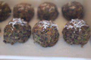 Beluga lentil meatballs, vegetarian, arranged in a row, by Foodjoya