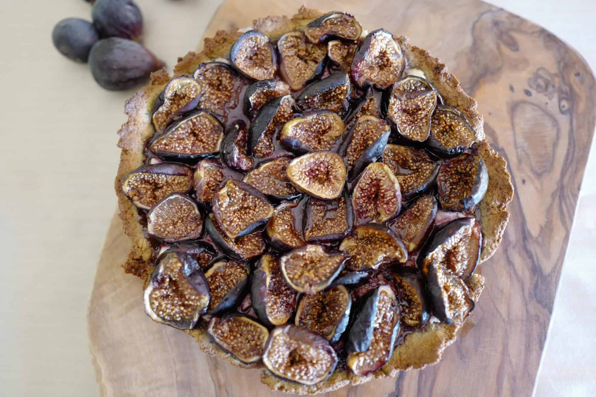 Top down view of Paleo Fig Tart (sugar-free, nutrient-dense) with goat cheese and almond-pistachio crust by Foodjoya